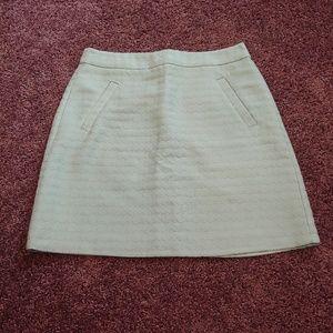 The limited gently worn seafoam green midi skirt